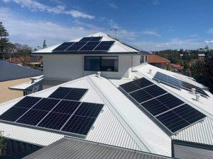 Several Solar Energy Panels on the white roof