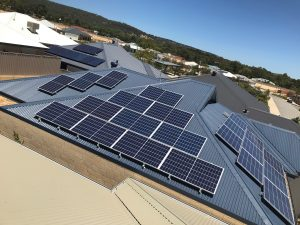 Several Solar Energy Panels on the blue roof